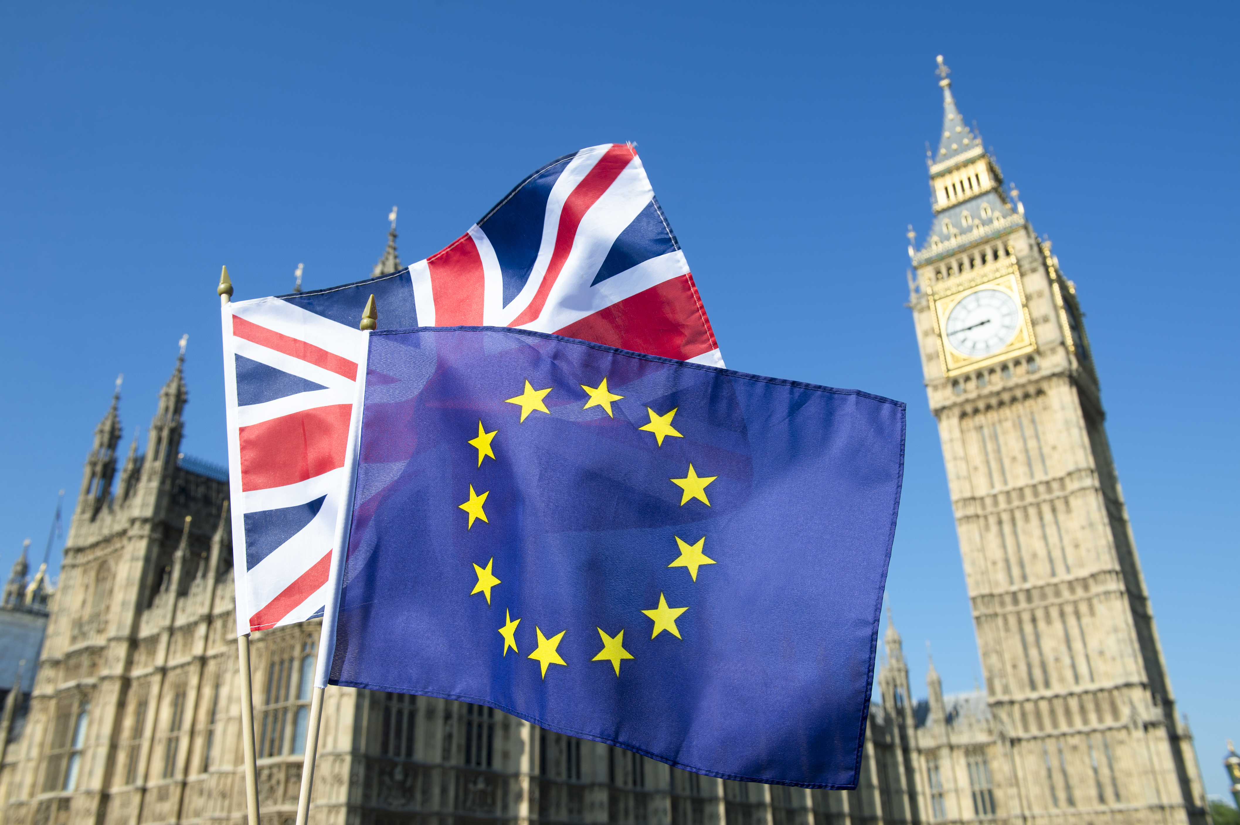 Picture of British and European flag in front of Big Ben