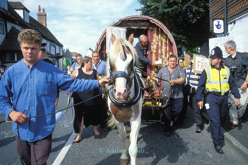 A horse and cart, led by Jake Bowers through Horsmonden, accompanied by police officers at a protest to keep the annual Horsmonden Fair alive