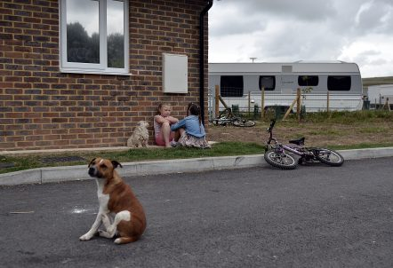 Two children sitting talking on a Traveller site